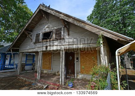 BAKERSFIELD, CA - JUNE 10, 2016: Pigeons are the sole occupiers of this abandoned house in the inner city.