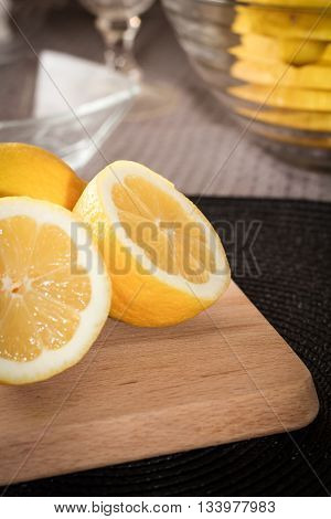Group of lemons in on a wooden cutting board