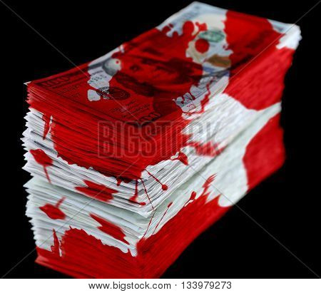 Stack of dollar banknotes with bloodstains isolated on black background