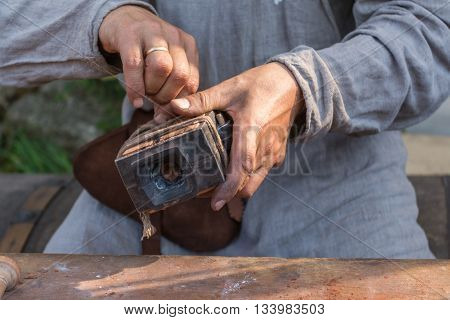 Artisan prepares for Bronze casting mold sandbox