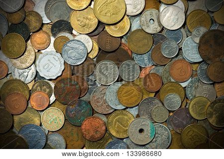Background with many old European metallic coins