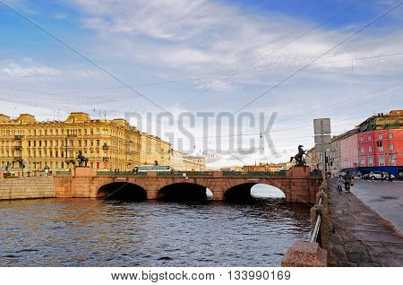 ST PETERSBURG RUSSIA - OCTOBER 20 2012. Architecture landscape - Anichkov bridge across Fontanka river. Anichkov Bridge is the oldest bridge across Fontanka River in St Petersburg Russia.