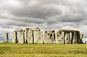 Stonehenge an ancient prehistoric stone monument near Salisbury, Wiltshire, UK. It was built anywhere from 3000 BC to 2000 BC. Stonehenge is a UNESCO World Heritage Site in England. poster