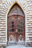 Vintage door on a old building facade in old Tallinn city Estonia poster