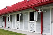 nice clean horse stables.  good lighting and color.  great detail. poster