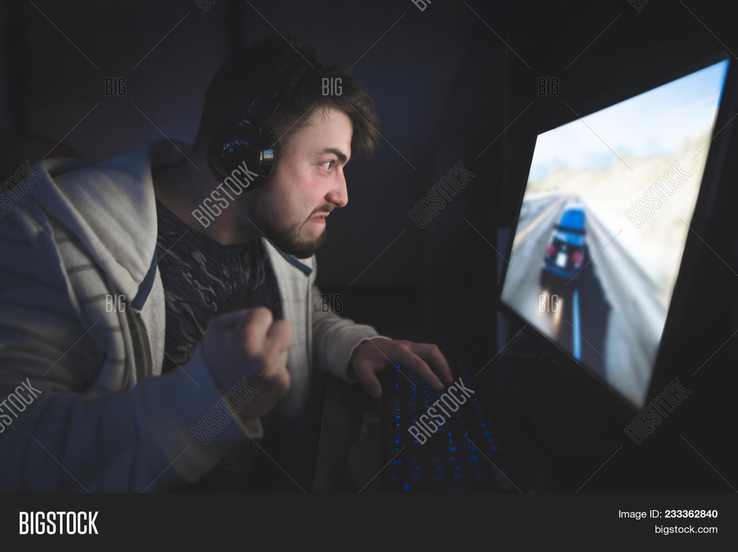 Emotion Gamer With Beard Playing Races At Home On A Computer Angry Young Man