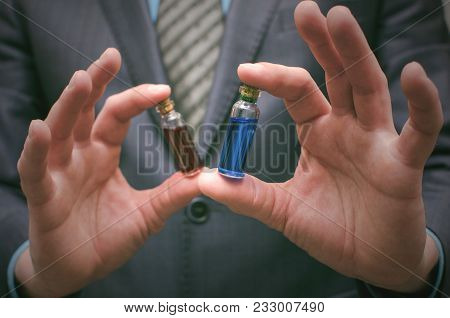 Blue And Red Pill Essential Liquid In Business Man Hands. Choosing Of Right Pill. Steroid Or Drug Pr