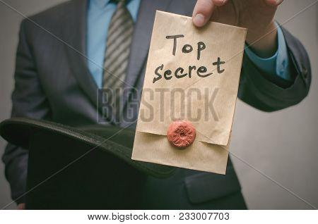 Top Secret Concept. Business Man Pick Out From Bowler Hat A Top Secret Documents. Confidential Dossi