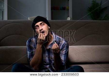 Young man in agony having problems with narcotics