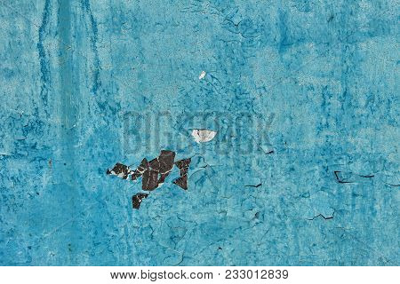 Old Blue Painted Metal Texture. Metal Surface With Peeling Cracked Paint. Peeling Paint On Painted M