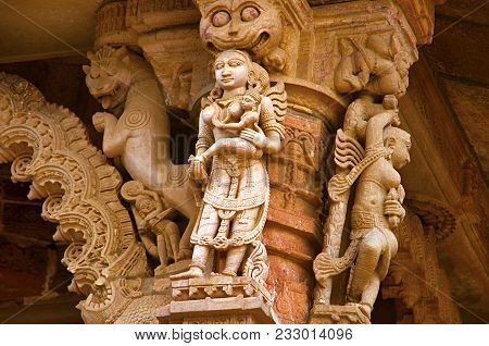 Carved idol on the outer wall, Hatkeshwar Mahadev, 17th century temple, the family deity of Nagar Brahmins. Vadnagar, Gujarat, India poster
