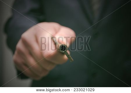 Key To Success Concept. Businessman Holding In Hands An Old Rusty Key And Opens The Door, Front View