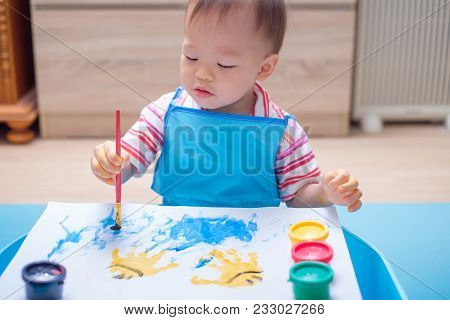 Cute Happy Little Asian 18 Months / 1 Year Old Toddler Baby Boy Child Painting With Paint Brush And