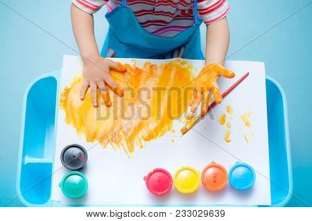 Bird Eye View / Top View Of Little Asian 18 Months / 1 Year Old Toddler Baby Boy Child Finger Painti