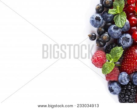 Mix Berries And Fruits At Border Of Image With Copy Space For Text. Ripe Blueberries, Blackberries,