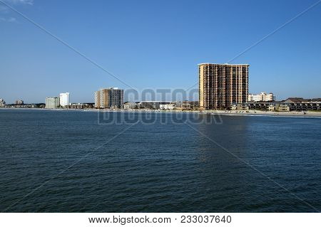Multiple Hotels Along The Atlantic Ocean Shoreline Under A Clear Blue Sky