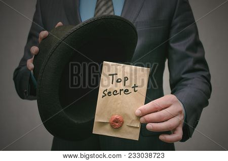 Top Secret Concept. Open The Secret. Business Man Takes Out Secret Documents From His Hat. Confident