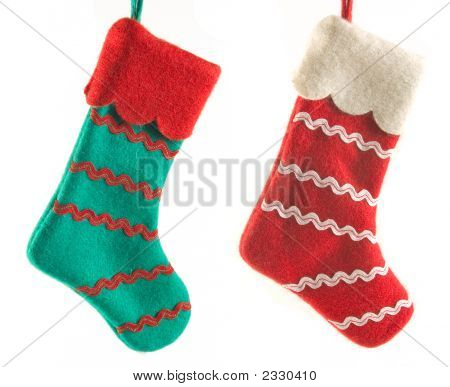 Two Christmas boots on a white