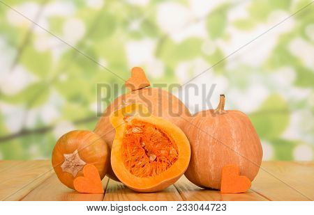 Two Large Gourd, Half Gourd With Seeds, Little Hearts Pumpkin, On Wooden Table