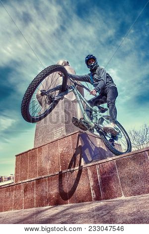 Moscow, Russia - March 2018: A Sports Cyclist Guy Doing Tricks On Bicycle In Urban Area. City Cyclin