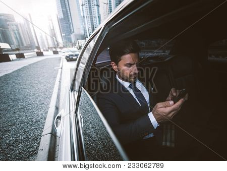 Business Man In His Limousine