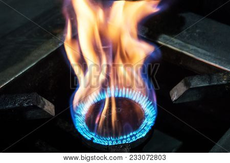 Gas Burning In The Burner Of Gas Oven. Big Flames Of Fire. Yellow Flames Close Up. Heavy Fire From T