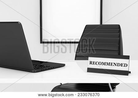 Expert Workplace Concept. Recommended Plate And Laptop On The Table In Front Of Black Leather Office