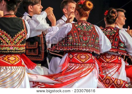 Romania, Timisoara - July 6, 2017: Dance Of Young Romanian Dancers In Traditional Costume Present At