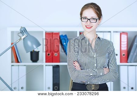 Beautiful Young Smiling Busines Woman Is Looking At Camera, Standing With Crossed Arms.
