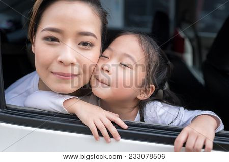 Beautiful Woman With Little Child Driving In Car.family Safety Transport Road Trip And Happy People