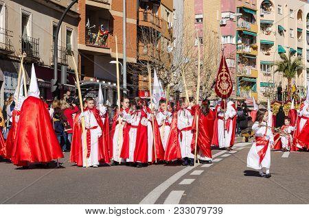 Sunday 17 March 2018, Badajoz, Spain.  Unidentified Children Participate In Palm Sunday Procession.
