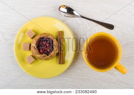 Pie With Cowberries, Sugar, Cinnamon In Saucer, Cup Of Tea, Teaspoon On Wooden Table. Top View