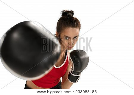 Young Active Beautiful Woman With The Black Boxing Gloves Boxing At Studio Isolated On White Backgro