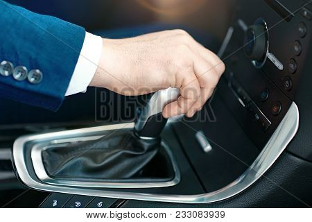 Male Hand On A Gear Shift Lever
