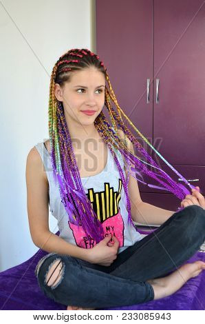 A Girl With A Fashionable Set Of Multicolored Braids Kanekalon. Colored Artificial Strands Of Hair.