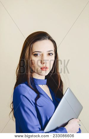 Portrait Girl With Laptop On Background Of Wall