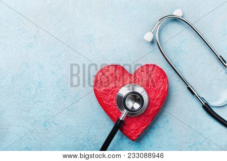 Medical Stethoscope And Red Heart On Blue Background Top View. Healthcare, Pulse, Heartbeat, Medicar