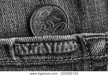 Euro Coin With A Denomination Of Fifty Euro Cents In The Pocket Of Worn Denim Jeans With Stripe, Mon