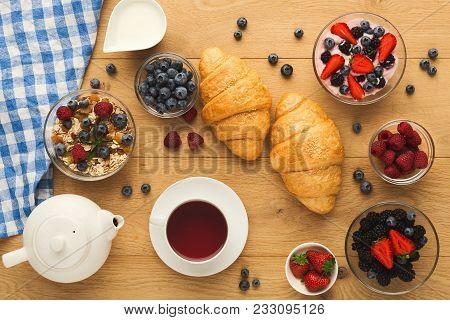 Rich Continental Breakfast. French Crusty Croissants, Muesli, Yogurt, Milk Jar, Tea Pot, Cup Of Hot