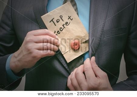 Top Secret Documents Presentation Concept. Top Secret Message In Detective Spy Agent Hands. Confiden