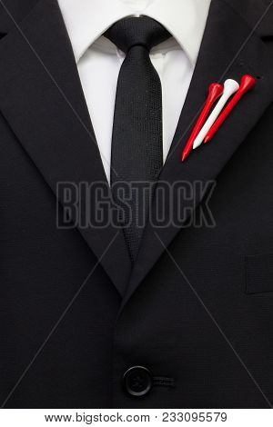 The Detail Of Wedding Suit With Golf Design.golf Tees In The Color Of Austria Flag On The Flap Of Bl