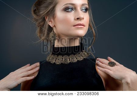 Girl With Fashionable Jewelry Necklace Earrings And Ring