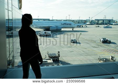 Frankfurt Am Main, Germany - October 11, 2015: Girl Silhouette Look At Planes On Airdrome Ground On