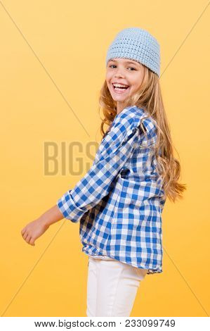 Happy Childhood, Youth. Small Girl Smile In Hat, Shirt And Pants, Fashion. Child Smiling With Long B