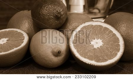 Cut Oranges Lying On A Wooden Table Monochrome Poster.
