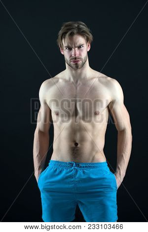 Man Athlete Show Muscular Torso In Blue Shorts, Fitness. Bodybuilder With Sexy Chest, Belly, Six Pac