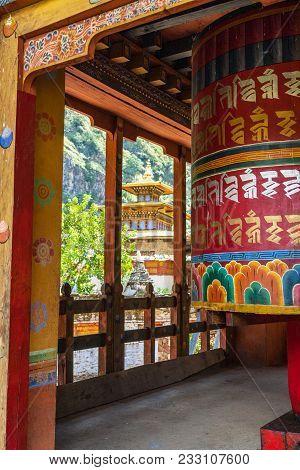 Prayer Wheel And Temple At The School Of The Buddhist Religion Near Chorten Kora - Bhutan