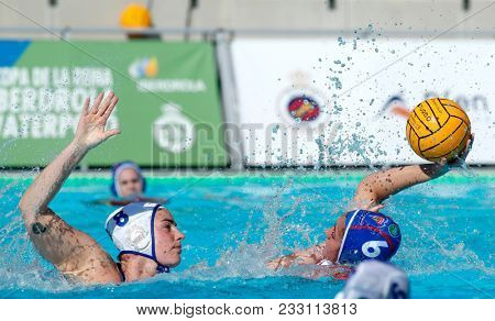 BARCELONA, SPAIN - FEB, 18: Angela Ruiz(L) of CN Terrassa vies with Maica Garcia(R) of CN Sabadell during a Copa Reina match at the J. Valles Swimming Pool on February 18, 2018 in Barcelona, Spain