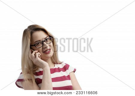 Serious Young Woman Talking On Phone Isolated On White. Copy Space And Fashion. Beautiful And Happy