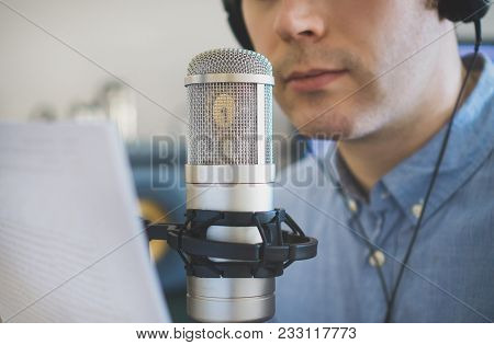 Man Recording An Advertisement On The Radio Station.